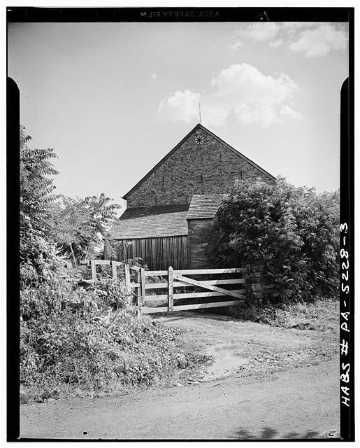3.  STONE END WITH WOOD ADDITIONS. NOTE EIGHT-POINT DESIGN, SLIT VENTILATORS, AND DATE STONE - Jacob & Elizabeth Miller Barn (1804), U.S. Route 30 vicinity, Lancaster, Lancaster County, PA