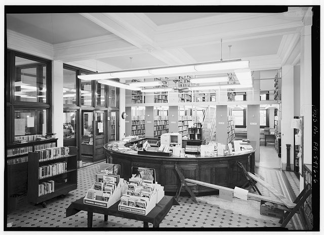 6.  INTERIOR, FIRST FLOOR, CIRCULATION DESK AND STACKS, LOOKING NORTHEAST - Carnegie Free Library, 301 South Pittsburgh Street, Connellsville, Fayette County, PA