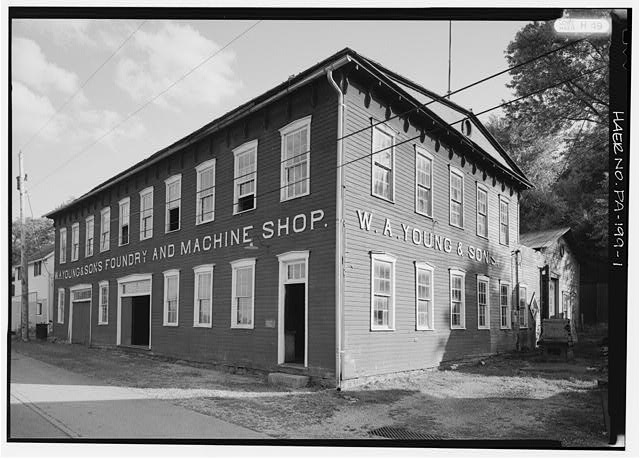 FRONT ELEVATION OF W.A. YOUNG MACHINE SHOP-LOOKING SOUTH. - W. A. Young & Sons Foundry & Machine Shop, On Water Street along Monongahela River, Rices Landing, Greene County, PA