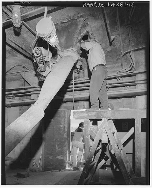 Inspecting load-out bin no. 7 in 1913 elevator - Stewart Company Grain Elevator, 16 West Carson Street, Pittsburgh, Allegheny County, PA