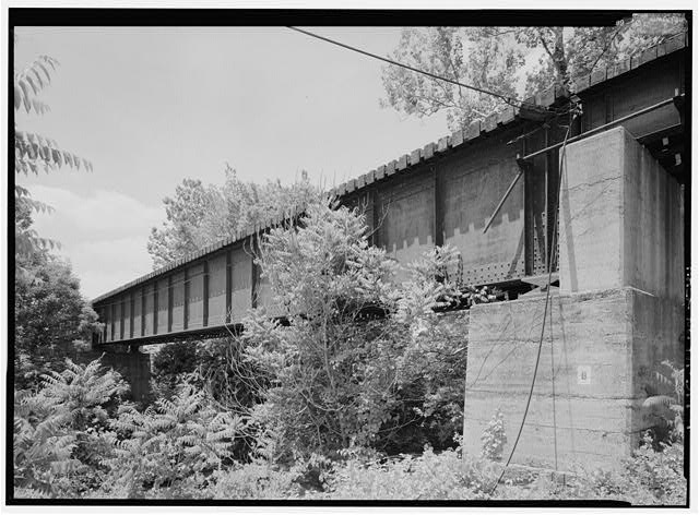 Perspective view of span over French Creek and east abutment, looking NW. - Pennsylvania Railroad, French Creek Trestle, Spanning French Creek, north of Paradise Street, Phoenixville, Chester County, PA