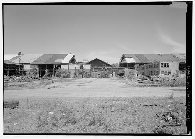 Middle section if south face of mill building, demolished shed in middle forming blank between buildings, right and left. - Phoenix Iron Company, Rolling Mill, North of French Creek, west of Fairview Avenue, Phoenixville, Chester County, PA