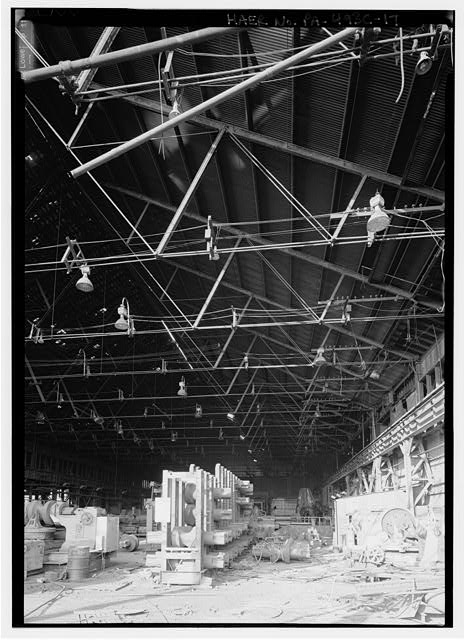 Interior of rolling mill at NW quadrant of structure, note stored rollers for various stands. - Phoenix Iron Company, Rolling Mill, North of French Creek, west of Fairview Avenue, Phoenixville, Chester County, PA