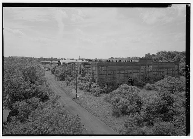 Girder shop, looking NW from Gay Street Bridge. - Phoenix Iron Company, Girder Shop No. 6, North of French Creek, west of Gay Street, Phoenixville, Chester County, PA