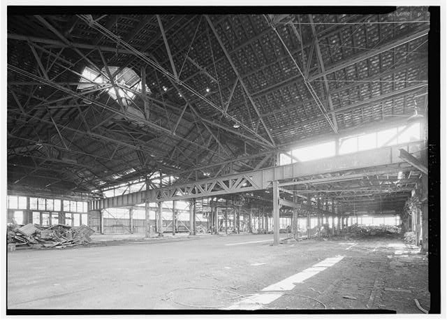 Interior of girder shop, from older section of shop showing older (1880's) construction of roof trusses.  Compare with earlier views in this series. - Phoenix Iron Company, Girder Shop No. 6, North of French Creek, west of Gay Street, Phoenixville, Chester County, PA