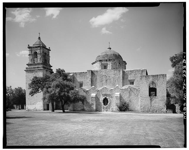 1.  GENERAL VIEW OF CHAPEL (smaller than church; to right of church). NOTE SERRATED PARAPET AND THE FAMOUS 'ROSE WINDOW' IN CENTER. ALSO NOTE BUTTRESSES. SOUTH SIDE.  - Mission San Jose y San Miguel de Aguayo, Chapel, 6539 San Jose Road, San Antonio, Bexar County, TX