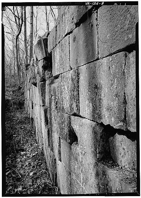 9.  East wall of Lock 1 showing deformation of masonry. 1971. - Potowmack Company: Great Falls Canal, Lock No. 1, Great Falls, Fairfax County, VA