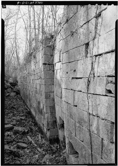 6.  East wall of Lock 2 looking N showing deformation of masonry. 1971. - Potowmack Company: Great Falls Canal, Lock No. 2, Great Falls, Fairfax County, VA