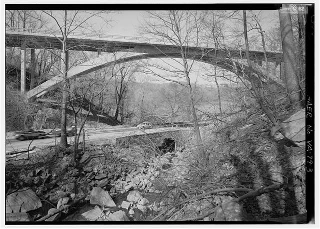 3.  SOUTH SIDE FROM SPOUT RUN LOOKING NNE WITH SPOUT RUN PARKWAY CULVERT IN BOTTOM CENTER OF VIEW. - Spout Run Arch Bridge, Eastbound, spanning Spout Run, Arlington, Arlington County, VA