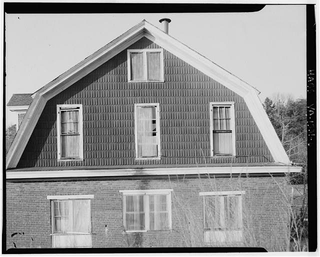 6.  EXTERIOR VIEW OF THE UPPER PORTION OF THE SOUTH ELEVATION - Canal Warehouse, Scottsville, Albemarle County, VA