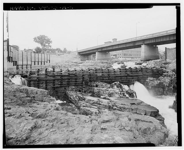 2.  VIEW NORTHEAST FROM WEST BANK, ROUTES 2 & 7 BRIDGE AND CHAMPLAIN MILL (HAER NO. VT-11) IN BACKGROUND - Burlington Woolen Mill Company, Dam, Winooski River, West of Bridge carrying U.S. Route 2&7, Burlington, Chittenden County, VT