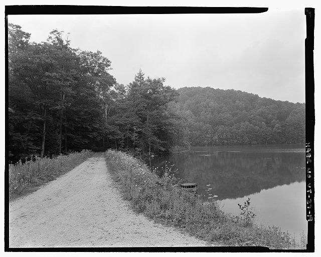 VIEW OF POGUE ROAD ACROSS TOP OF DAM. VIEW WNW - Marsh-Billings-Rockefeller Carriage Roads, Woodstock, Windsor County, VT