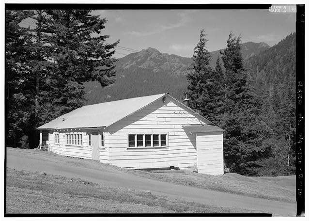 "MAINTENANCE SHOP (THE ""BUNKHOUSE"")-- ONLY SURVIVING BUILDING FROM THE ORIGINAL CONSTRUCTION CAMP BUILT IN 1926.  PHOTO BY JET LOWE, HAER, 1995. - Elwha River Hydroelectric System, Glines Hydroelectric Dam & Plant, Port Angeles, Clallam County, WA"