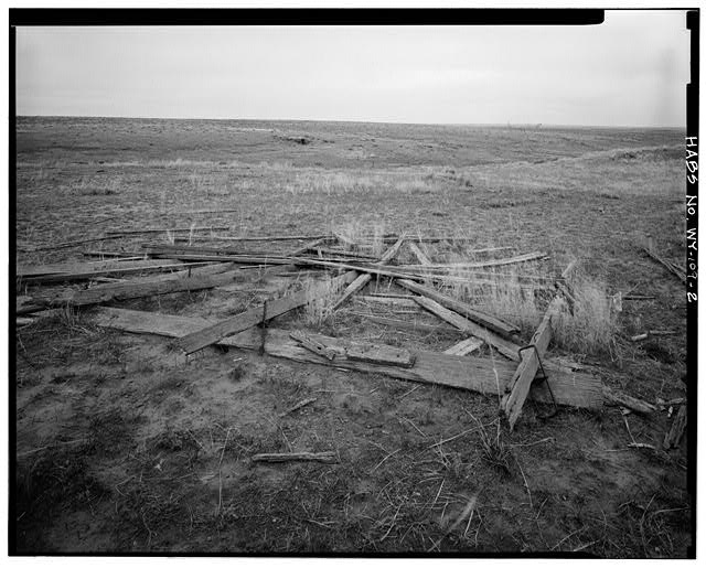 2.  REMAINS OF WAGON WITH DUGOUT IN BACKGROUND, VIEW TO WEST - Rock Well Homestead, 15 miles Southeast of Wright, Wright, Campbell County, WY
