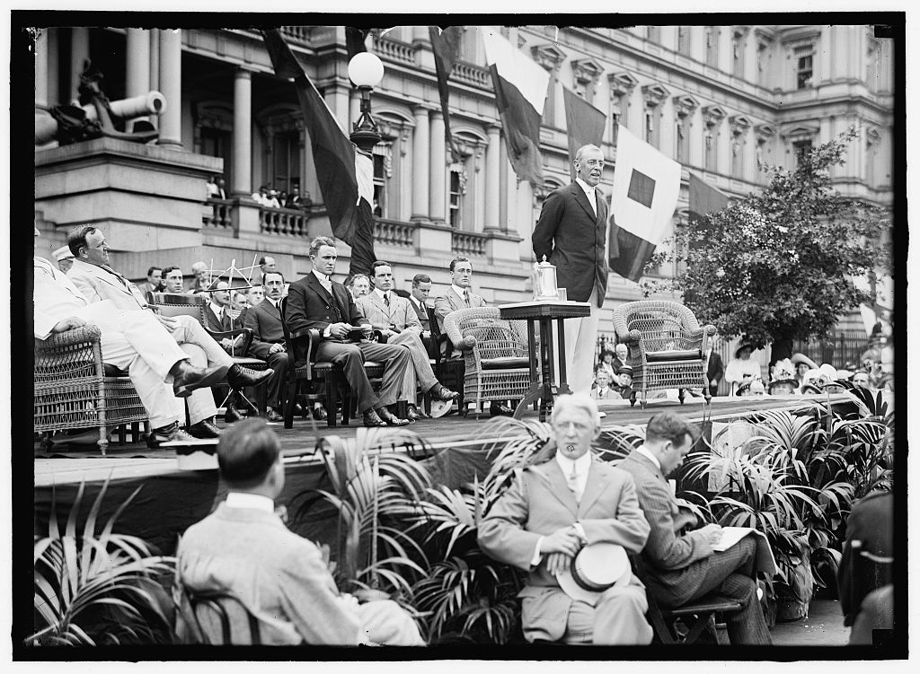 Caption from the Library of Congress:  Flag Day exercises, State, War, and Navy Building. Wilson speaking; Bryan, Daniels, [Breckinridge Long], William Phillips, F.D. Roosevelt, etc. present