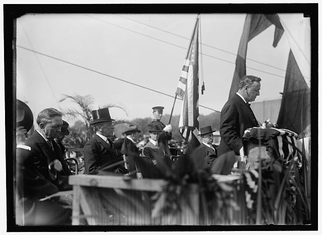 MEMORIAL AMPHITHEATRE, ARLINGTON. CORNERSTONE LAYING. LEFT, ELIOT WOODS; 2ND FROM LEFT, PRESIDENT WILSON; SEC. DANIELS, PRAYING