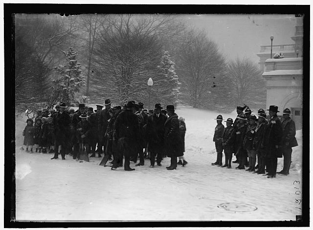 [Group outside White House in snow]