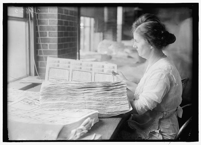 [Woman holding $50 bonds, probably Liberty Bonds. Engraving and Printing, Bureau of Treasury Dept.]