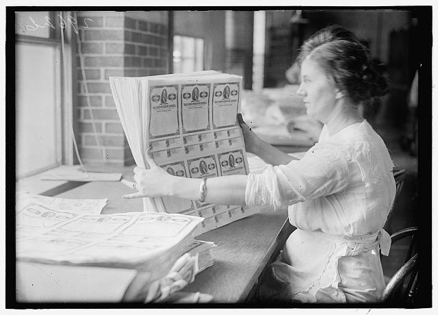 [Woman holding $50 bonds, probably Liberty Bonds. Engraving and Printing, Bureau of Treasury Dept.