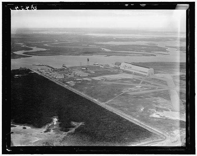 Air shot, Cape May (N.J.) Coast Guard Station Airport, showing new runways and the old air ship hanger built by the Navy for one of the treaty Zeps after the World War, but now not in use