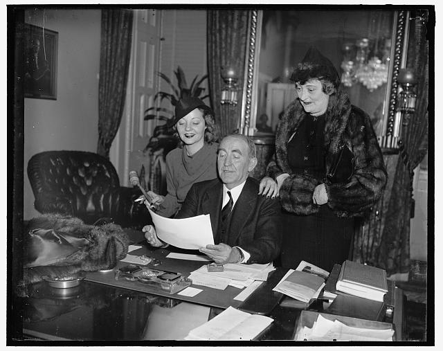 "Bankheads together again. Washington, D.C. Speaker of the House William B. Bankhead forgot his official duties for a while today to welcome his talented actress daughter, Tallulah, at the Capitol today. Miss Bankhead is in the Capitol to open in a new play ""Reflected Glory."" Left to right: Tallulah Bankhead, Speaker of the House, and Mrs. Bankhead"