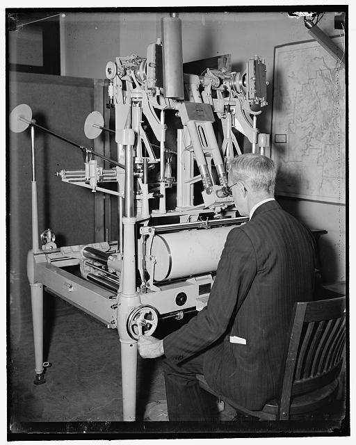 Geological Survey, Dept. Interior. Washington, D.C., Mar. 13. E.A. Shuster working with the erocartograph constructing topographies from airplane pictures