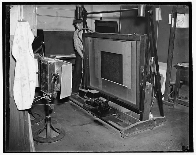 Washington, D.C., Mar. 13. H.C. Yates with the process printing frame printing direct from negative to metal plate. At the geological survey