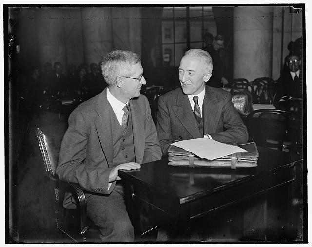 Appear before the Senate Judicary. Washington, D.C., March 18. Appearing before the Senate Judicairy Committee today in defense of the Presidents Supreme Court reorganization plan were Charles Grove Haines of the University of Calif. who is a Professor of Political Science, left: and Dean Leon Green, Dean fo the Law School of Northeaster Univ., right