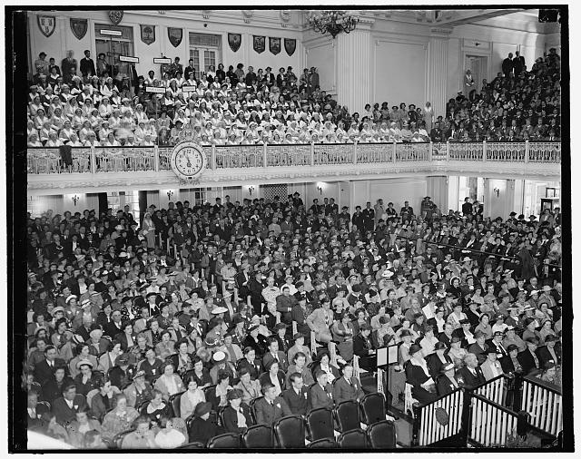 Red Cross open their annual convention. Washington, D.C., May 10. A general view of the assembly as their Red Cross opened their annual convention in Washington today. The famous 'gray ladies' can be seen grouped in the balcony, 5/10/1937