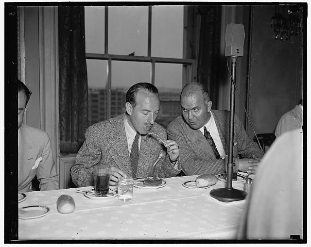 Belgian Premier lunches with newsmen. Washington D.C. June 25. The Premier of Belgium, Dr. Paul Van Zeeland, was luncheon guest of the National Press Club today. He is shown with Charles O. Gridley, (right) President of the club, 6/25/37