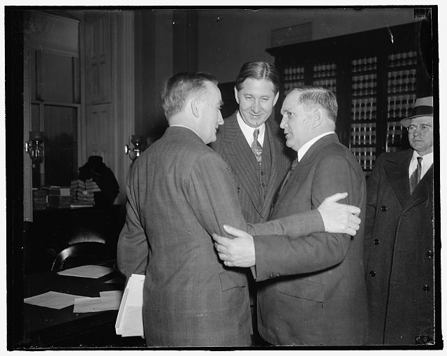 In spotlight at Senate Committee hearing, Tom Mooney petition. Washington, D.C., Dec. 15. Senator Joseph C. O'Mahoney, (left) Senator James E. Murray, and John W. Jenkins, Chairman of the Tom Mooney Defense Committee, go into a huddle just before the Senate Judiciary Subcommittee opened its meeting today to hear a petition to summon Mooney to testify at hearings on a Senate resolution urging his freedom. Frank P. Walsh, counsel for Mooney, presented the petition, 12/15/37