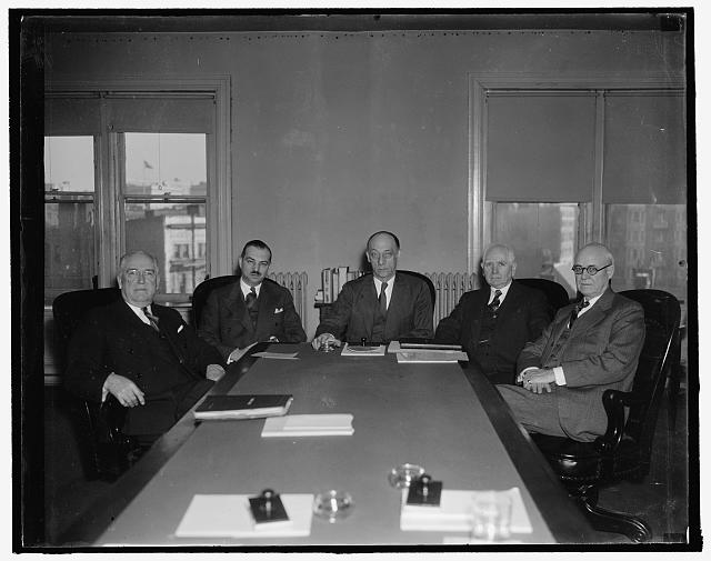 Federal Trade Commission. Washington, D.C., Jan. 3. The first picture of the Federal Trade Commission with the newly elected Chairman Garland S. Ferguson, presiding. Left to right: Charles H. March, Robert E. Freer, Chairman Garland S. Ferguson, Ewin L. Davis, and William A. Ayres, 1/3/38