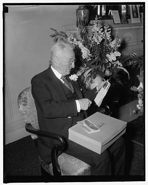 Virginia senator celebrates 80th birthday. Washington, D.C., Jan. 4. Senate duties were forgotten by Senator Carter Glass today as he celebrated his 80th birthday anniversary surrounded by his family. He is shown reading congratulatory wires sent him from all parts of this country and abroad, 1/4/38