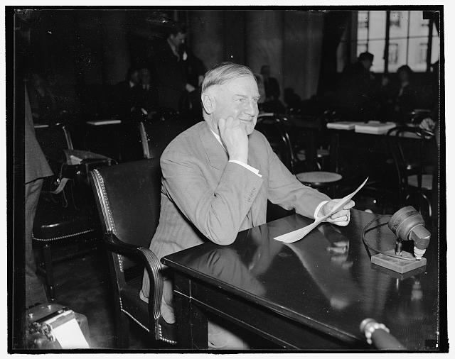 "Sears-Roebuck head testifies. Washington, D.C., Jan. 7. Appearing before the Special Senate Committee investigating unemployment today, Robert E. Wood, President of Sears-Roebuck Co., declared that business ""lacked confidence and was scared"" in response to questions by the committee, Wood, said however, that the President's message to Congress was ""reassuring,"" 1/7/38"