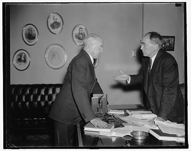Washington, D.C., Jan. 10. Rep. Hatton W. Sumners, Democrat of Texas, who is being mentioned as a probable candidate to succeed Justice George Sutherland on the United States Supreme Court, is shown talking with Speaker Bankhead, 1/10/38