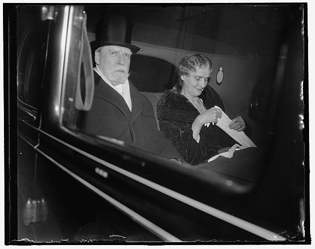 White House reception for Judiciary. Washington, D.C., Jan. 11. The Chief Justice of the Supreme Court Charles Evans Hughes and Mrs. Hughes are shown as they left their residence for the White House reception for the Supreme Court and the Judiciary, 1/11/38