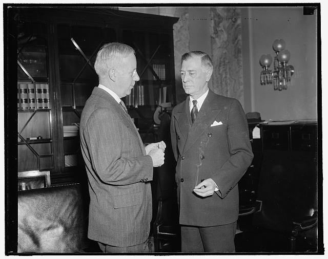 Admits Army finance office honored allegedly fraudulent CCC vouchers. Washington, D.C., Jan. 18. Major General Walter L. Reed, (left) Inspector General of the Army, today told Senator Key Pittman, Chairman of the Senate Public Lands Committee, the Army Chief Finance Offi[...] honor allegedly fraudulent CCC vouchers in go[...] faith. Reed made this declaration as he was [...] by the committee on the alleged defalcations o[...] Stitley, former Chief Voucher Clerk for the CCC [...] totaling $87,000, 1/18/38