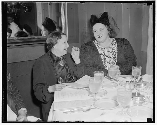 Songbird of the South has lunch at the Capitol. Washington, D.C., Feb. 15. Sen. Hattie Caraway, of [...], photographed while having luncheon with [...]te Smith, radio star at the Capitol restaurant today, 2/15/38