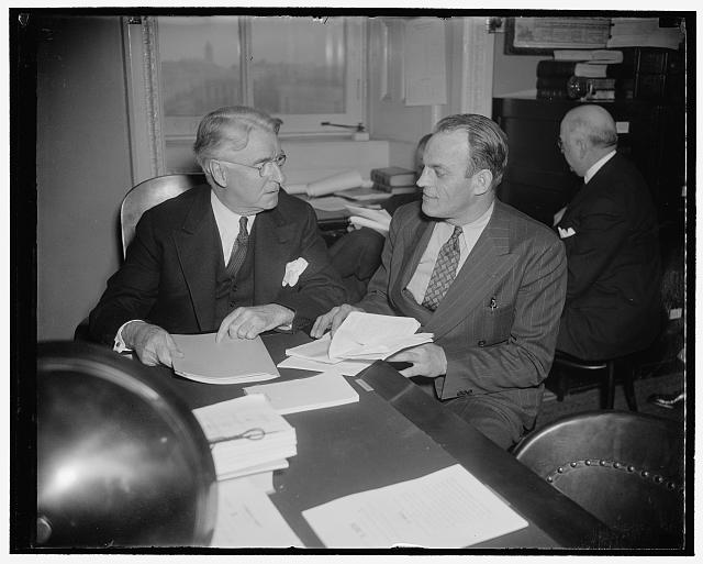"NMU head denies he's a communist. Washington, D.C., Feb. 17. Joseph Curran, President of the National Maritime Union, today told the Senate Commerce Committee that ""I have not been a Communist, I am not a Communist and I do not believe that I ever intend to be a Communist."" Curran, (right) shown with Senator Royal S. Copeland, Chairman of the committee, was accused last week of being a Communist by Joseph P. Ryan, President of the International Longshoremen's Association, an A.F. of L. affiliate, 2/17/38"