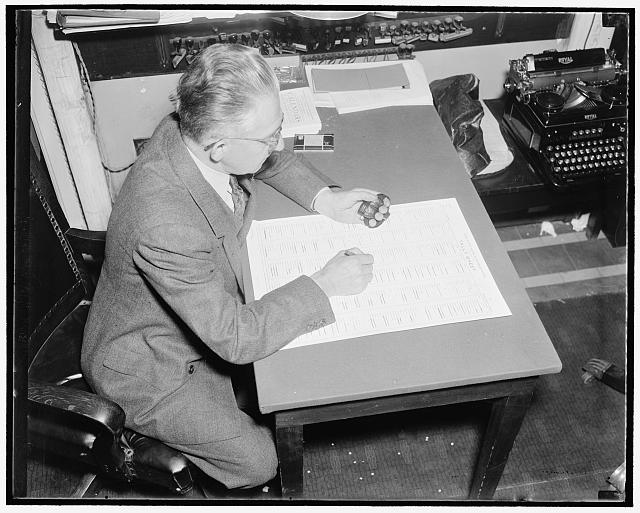 "How a bill become a law. After discussion and debate on the merits and defects of the bill as presented or amended, a vote is taken either by ""aye & nay"", tellers, or tally. This picture shows Hans Jurgensen, tally clerk of the house recording the results of a tally vote"