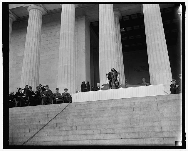 Washington's prominent figures listen to Marian Anderson's singing. Washington, D.C., April 9. Behind Marian Anderson, the heroic statue of Lincoln; beside her, Cabinet members and Senators; before her a crowd of 75,000 black and white listeners. Left to right - Secretary of the Treasury Henry Morganthau, Mrs. Morganthau, Secretary of the Interior Harold Ickes, [...] at the piano, Marian Anderson. 4-9-39