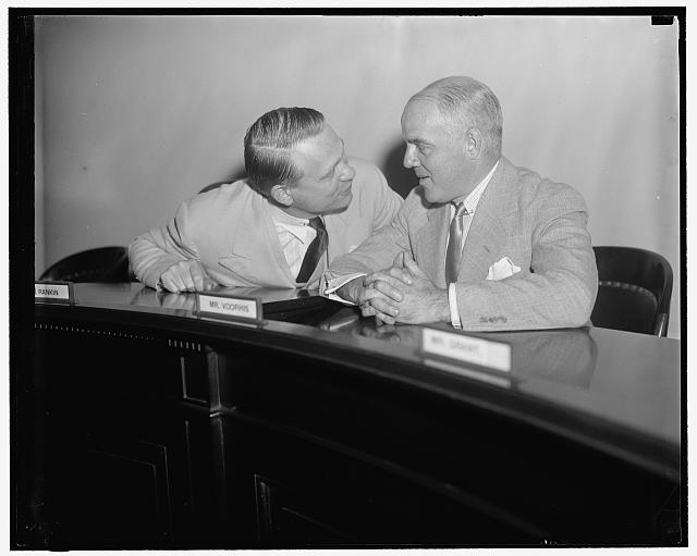Two foes of Un-Americanism in conference. Washington, D.C., May 23. Martin Dies, chairman of the House Committee Investigating Un-American Activities, and Rep. J. Parnell Thomas, who recently sponsored a bill of impeachment against Secretary of Labor Perkins. Both members of the Dies Committee put their heads together this morning for a conference about the coming testimony of Felix McWhirter
