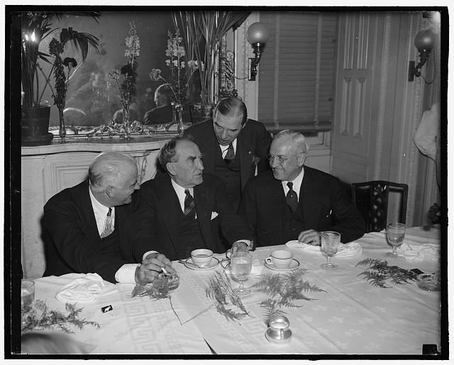 [William Bankhead and group at table]