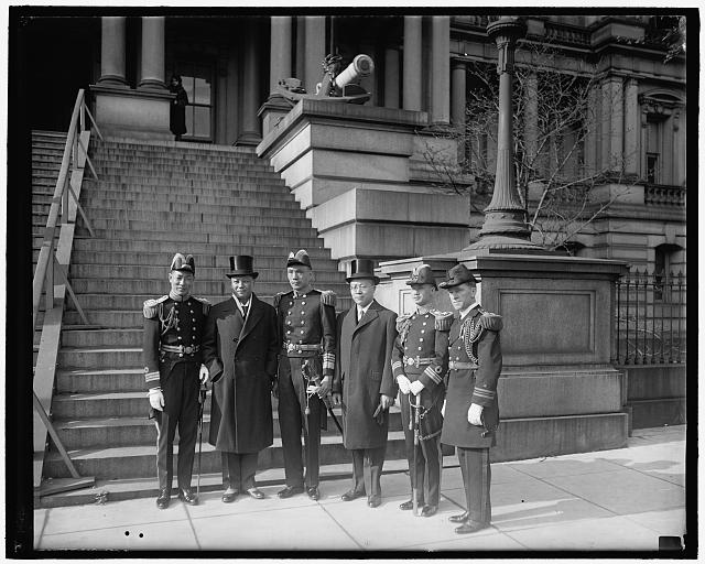 Chinese on world tour. Chinese Naval officers on world tour meet President Hoover. Photographed in front of the temporary White House executive offices, left to right, they are: Comdr. S.C. Whang, Mr. Hollington K. Tong, Admiral H.K. Tu, Minister C.C. Wu, Lt. Comdr. M.H. Ching, and Lt. Comdr. T. De Witt Carr, U.S.N.