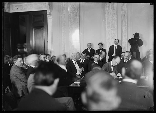 [Congressional meeting? Robert M. La Follette, Jr. in background]