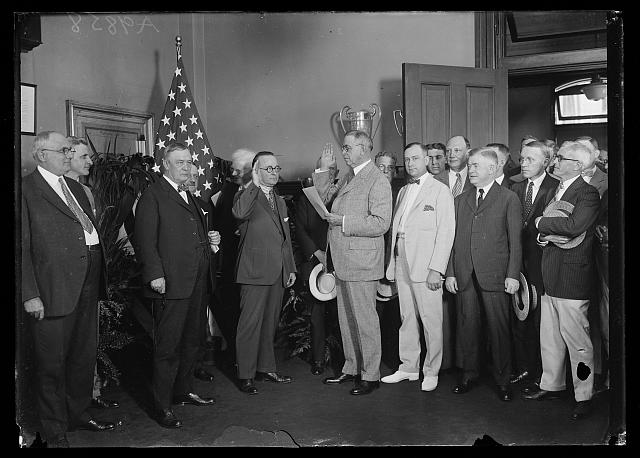 [Group at swearing in; includes Harry S. New, center left, and Hubert Work, center right]