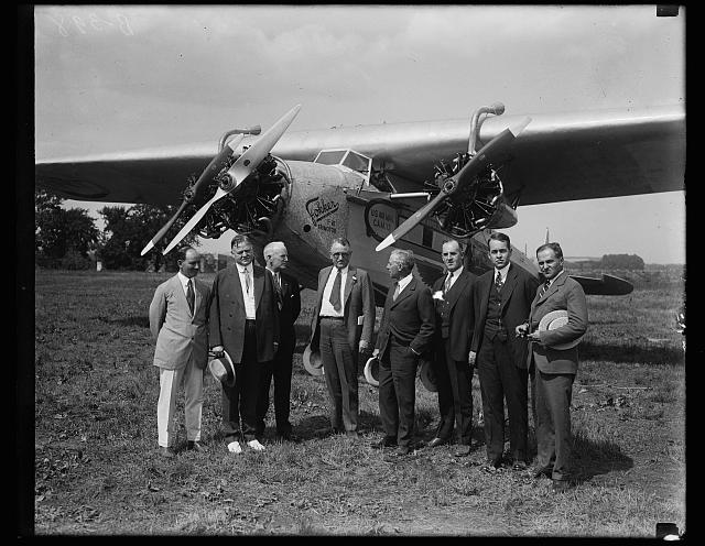 [Group at U.S. Air Mail airplane; Herbert Hoover, 2nd from left]