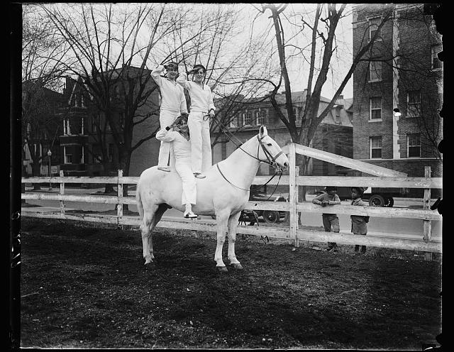 "Washington society youngsters impersonate ""Horse Marines"" at children's horse show. The Misses Jinks of the Horse Marines all set for the Children's Horse Show which will be held in the National Capital on St. Patrick's Day. They are, left to right: Margaretta Rowland; Katrina McCormick, daughter of Mrs. Medill McCormick of Illinois and Miss Anne Rollins"