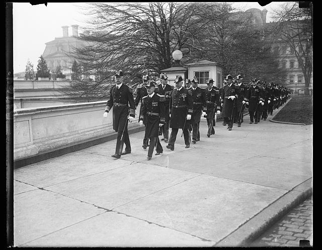 The Navy at the White House. Officers of the United States Navy arriving at the White House for annual New Year's Reception. In the lead, Admiral Charles F. Hughes, chief of Naval operations and Admiral T.J. Cowie (retired) former Paymaster General