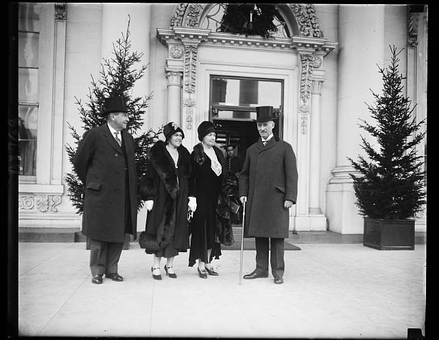 Justice Harlan F. Stone, Mrs. Stone, Mrs. Henry Lewis Stimson and Secretary of State Stimson as they appeared at the White House for the New Years reception